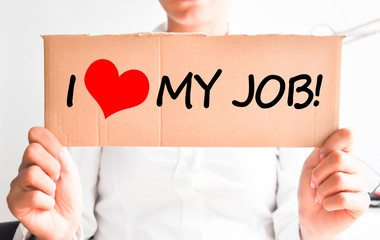 Employee Holding Sign That Says I Love My Job