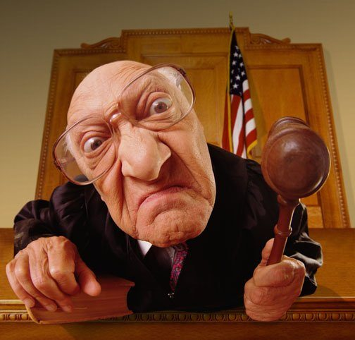 Judge With Mean Face Holding Gavel