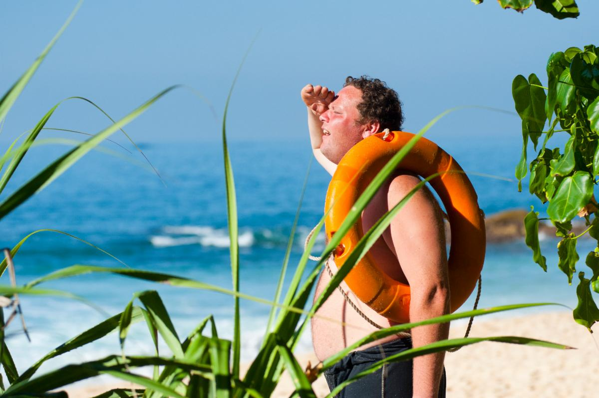 Man On Beach Searching Far Off