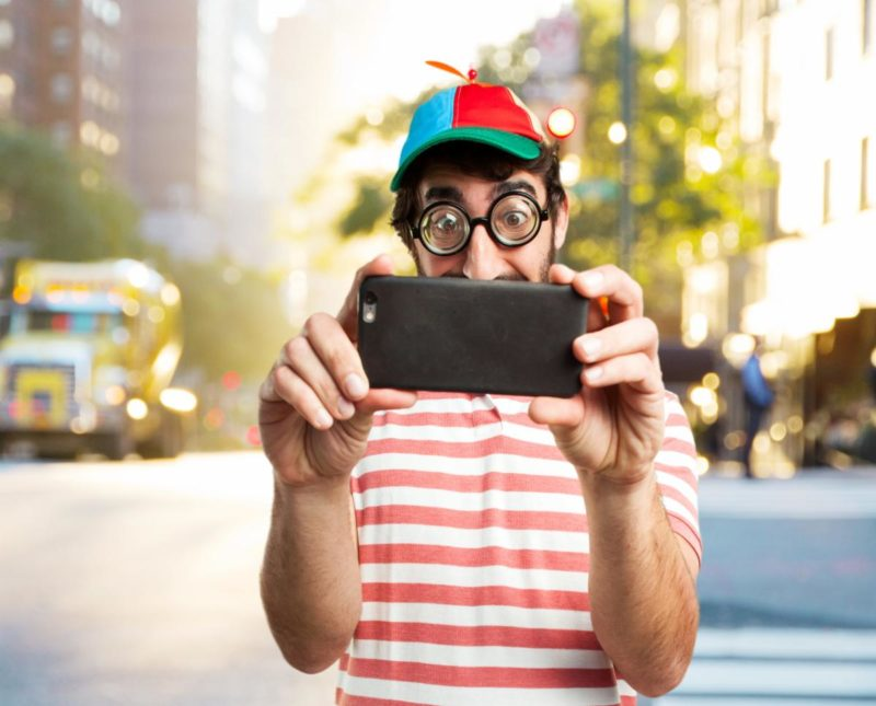 Goofy Looking Man Holding Smartphone