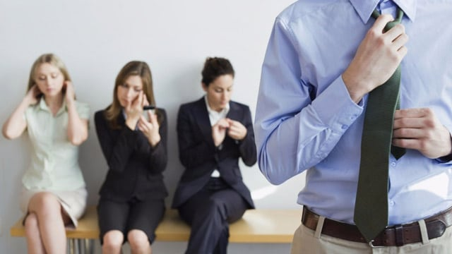 People Waiting For Interview, Man Straightening Tie