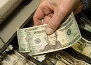 Cash Register Filled With Cash